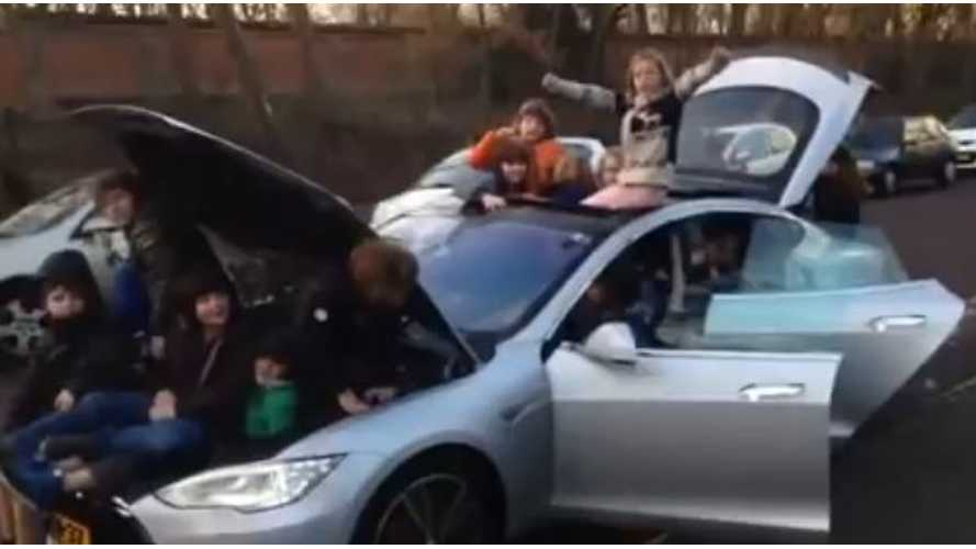 Video: 28 Kids Pile Into and Onto a Tesla Model S