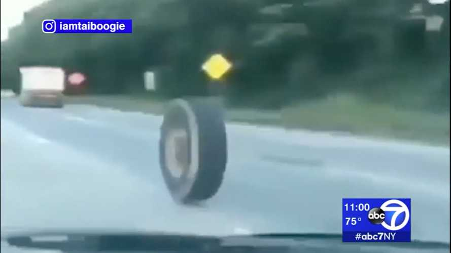 See a tipper lorry tyre roll down motorway and destroy a Jeep
