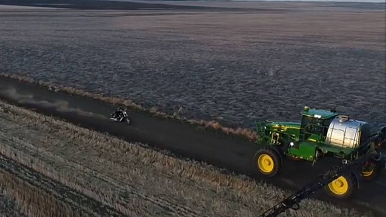 Crazy Canadian Stuntman Rides Full Tilt Under Farm Equipment