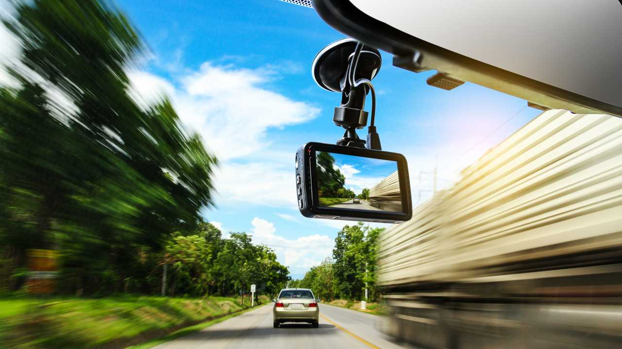 View of dash cam on windscreen while driving