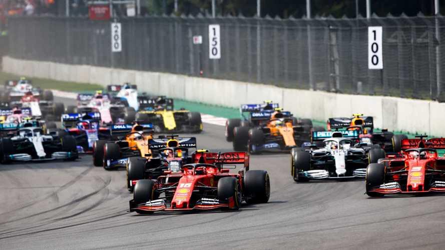 Charles Leclerc, Ferrari SF90, leads Sebastian Vettel, Ferrari SF90, Lewis Hamilton, Mercedes AMG F1 W10, Max Verstappen, Red Bull Racing RB15, Carlos Sainz Jr., McLaren MCL34, and the rest of the field at the start