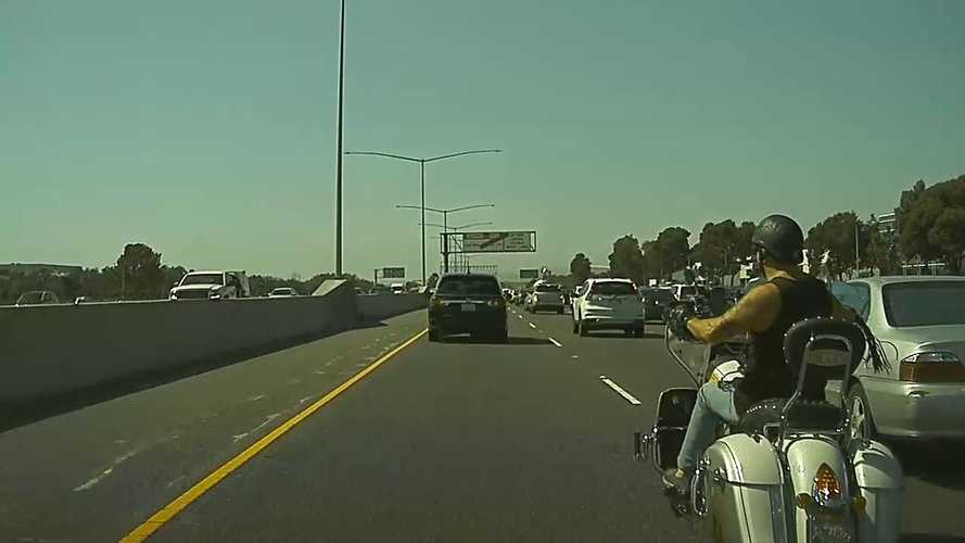 Watch Tesla Dashcam Capture Angry Lane-Splitting Motorcyclist