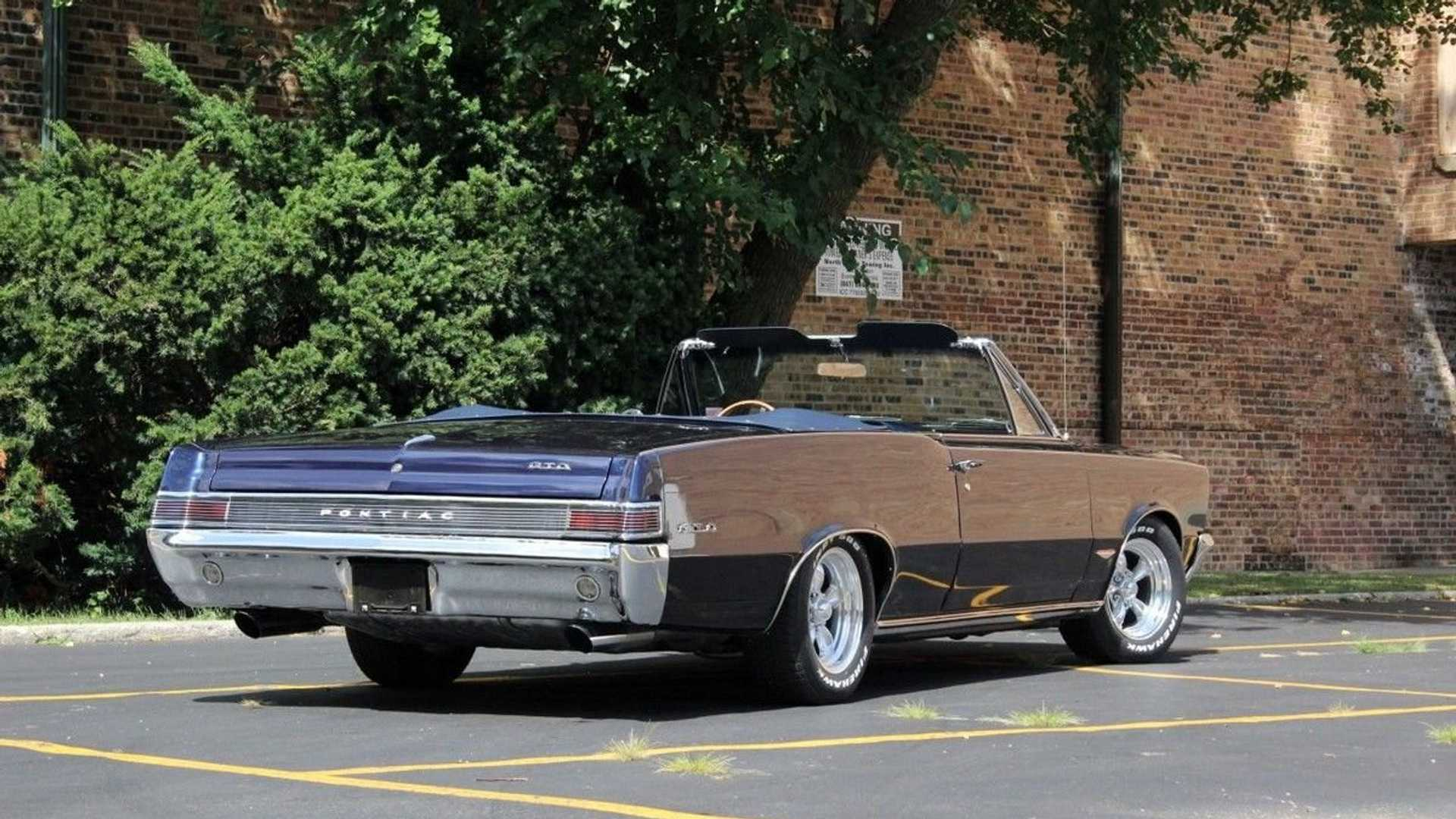 "[""This 1965 Pontiac GTO Convertible Is One Sleek Machine""]"