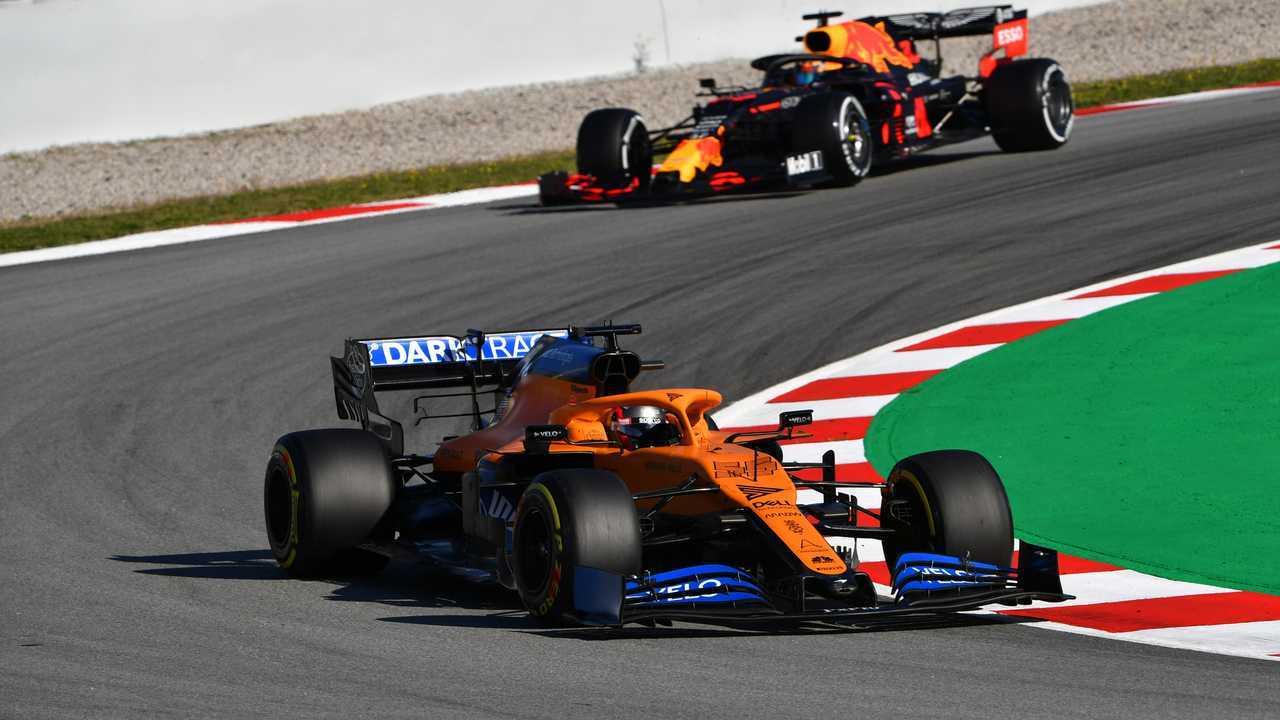 Carlos Sainz Jr., McLaren MCL35 leads Alex Albon, Red Bull Racing RB16