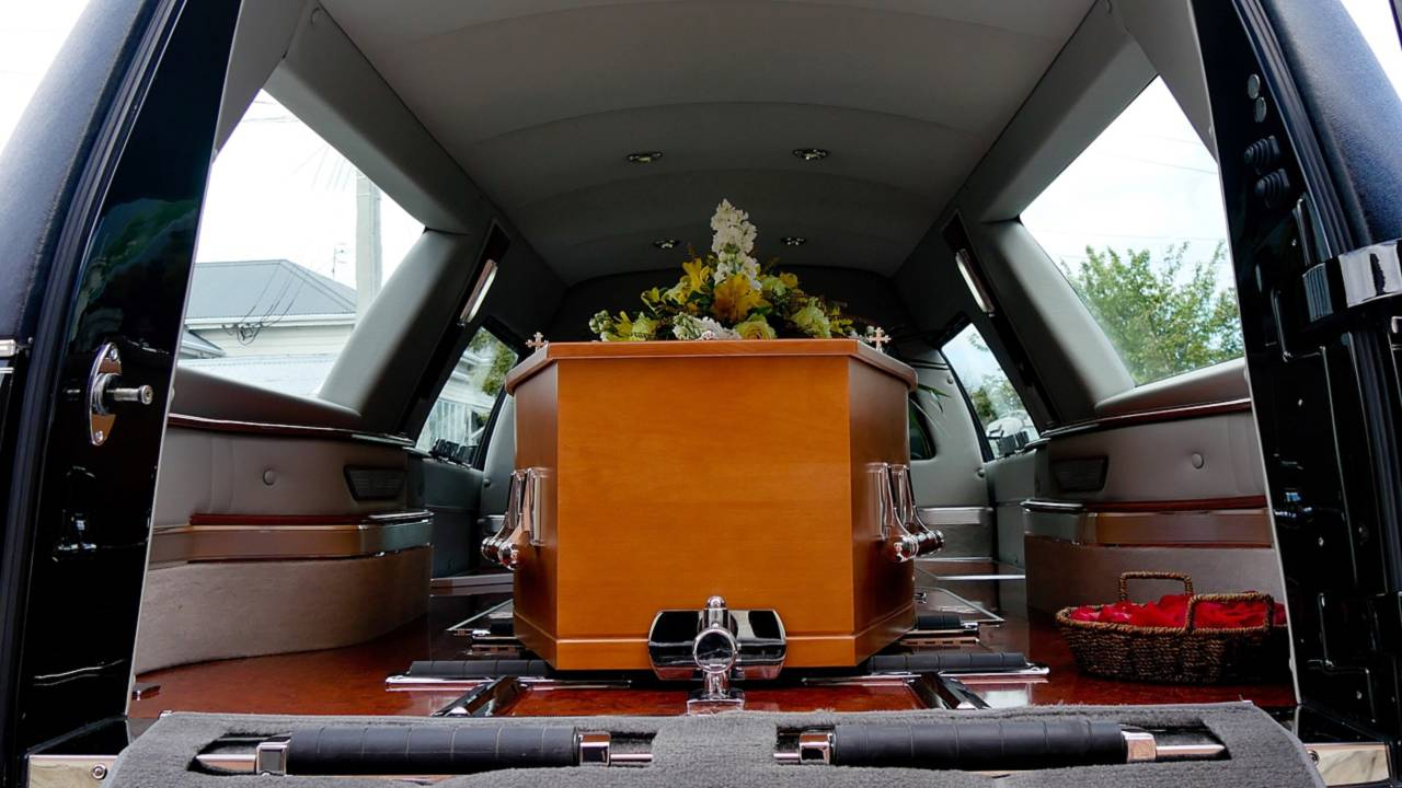 Hearse with coffin left by road