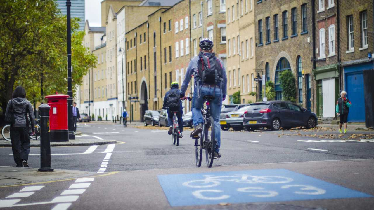 Cyclists commuting to work on the Cycle Superhighway 3 between Canary Wharf and Wapping London