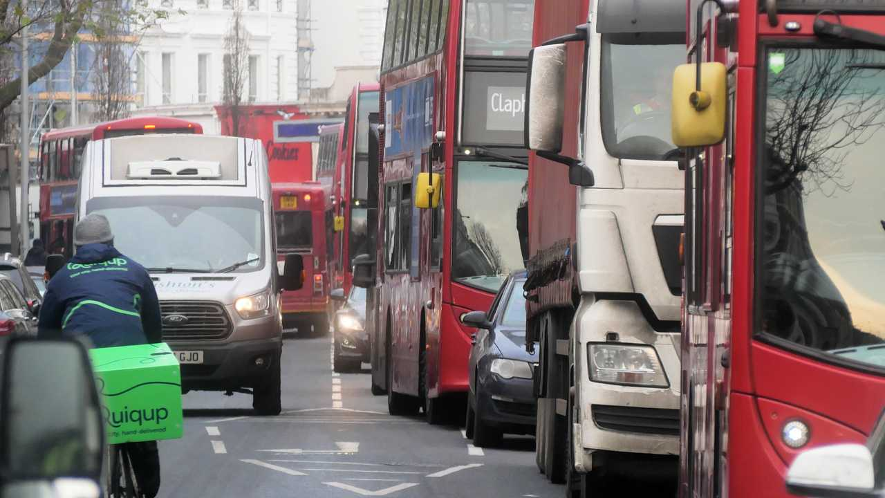 Heavy traffic with buses and vans in London UK