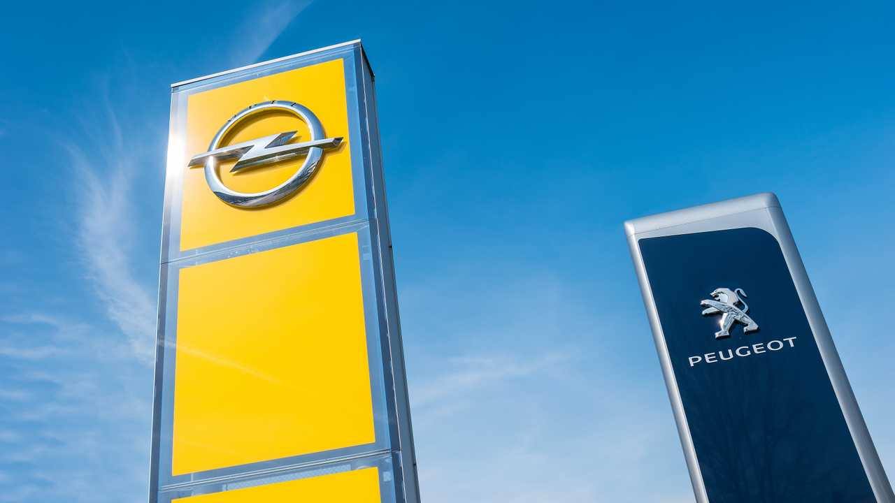 Peugeot and Opel dealership signs in Aachen Germany