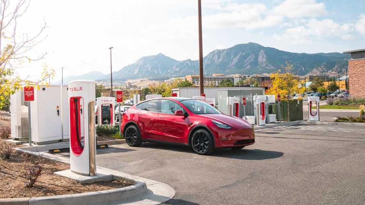 Tesla Model Y charging at a Supercharging station