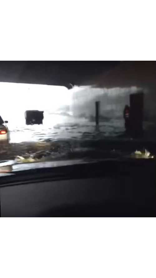 Tesla Model S Drives Through Flooded Tunnel - Video