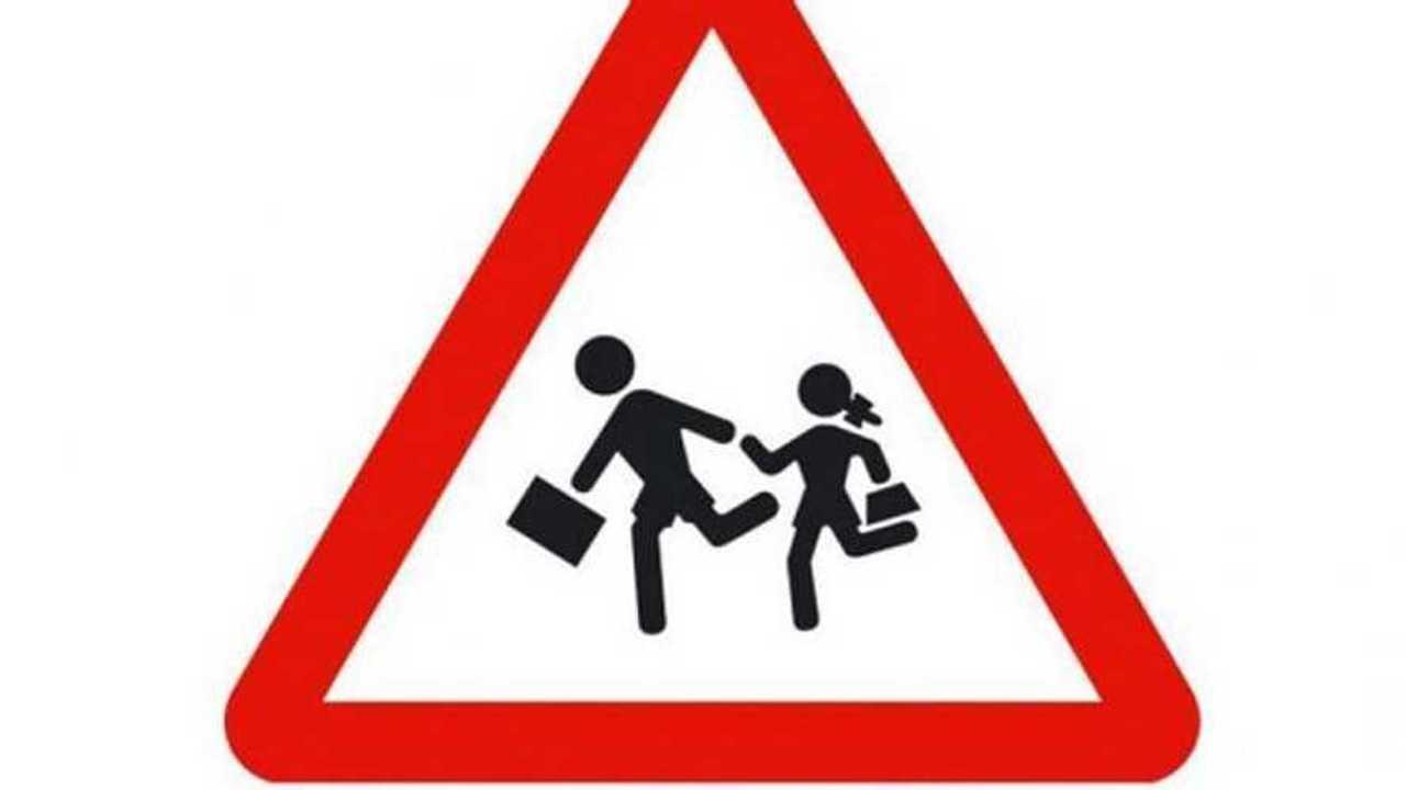 Señal de peligro por proximidad de un colegio
