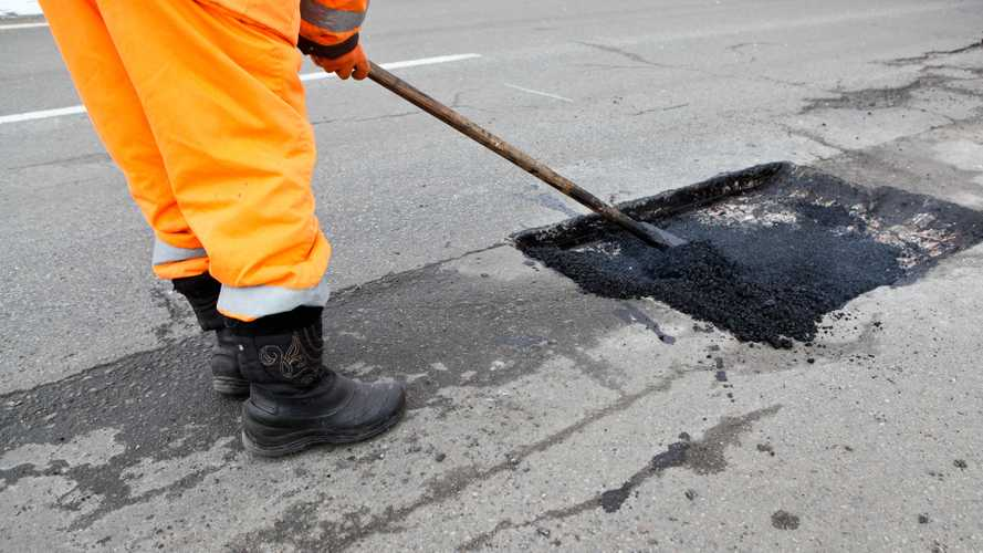 Government confirms extra £201m fund to fix potholes