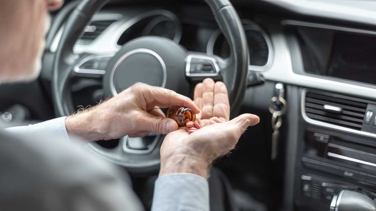 Man taking drugs before driving his car