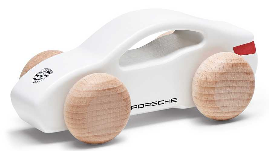 Porsche Taycan merchandise includes this cute wooden toy car
