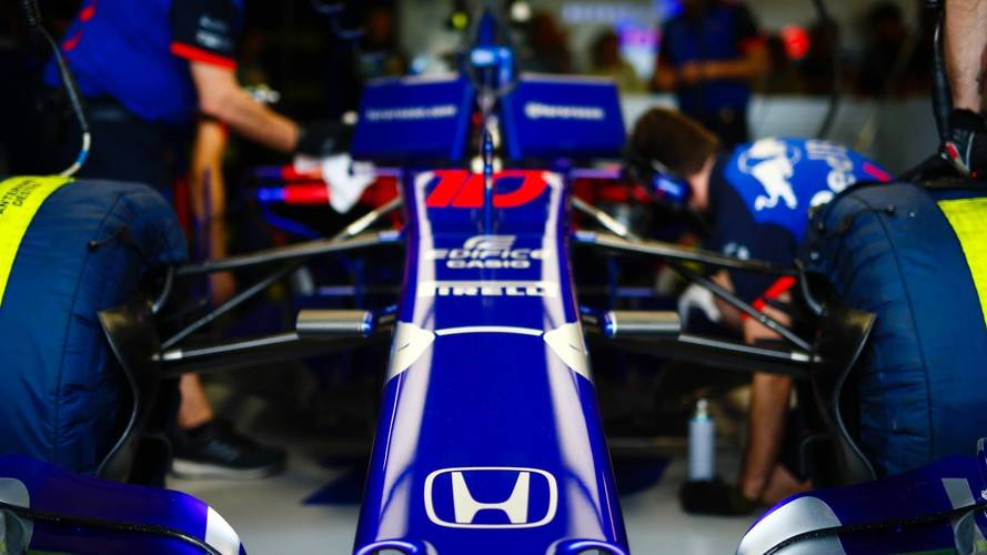 Engineers work on the car of Pierre Gasly, Toro Rosso STR13 Honda, in the garage