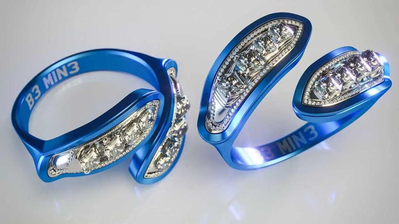 Cincin pertunangan ini terbuat dari suku cadang mobil daur ulang dan dirancang menyerupai lampu Ford Fiesta.se engagement rings are made from recycled car parts and are designed to resemble the lights