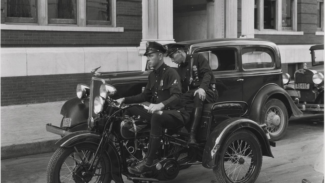 Police officers marking tires using a Servi-car, circa 1934. Photo courtesy of the HD Archives.