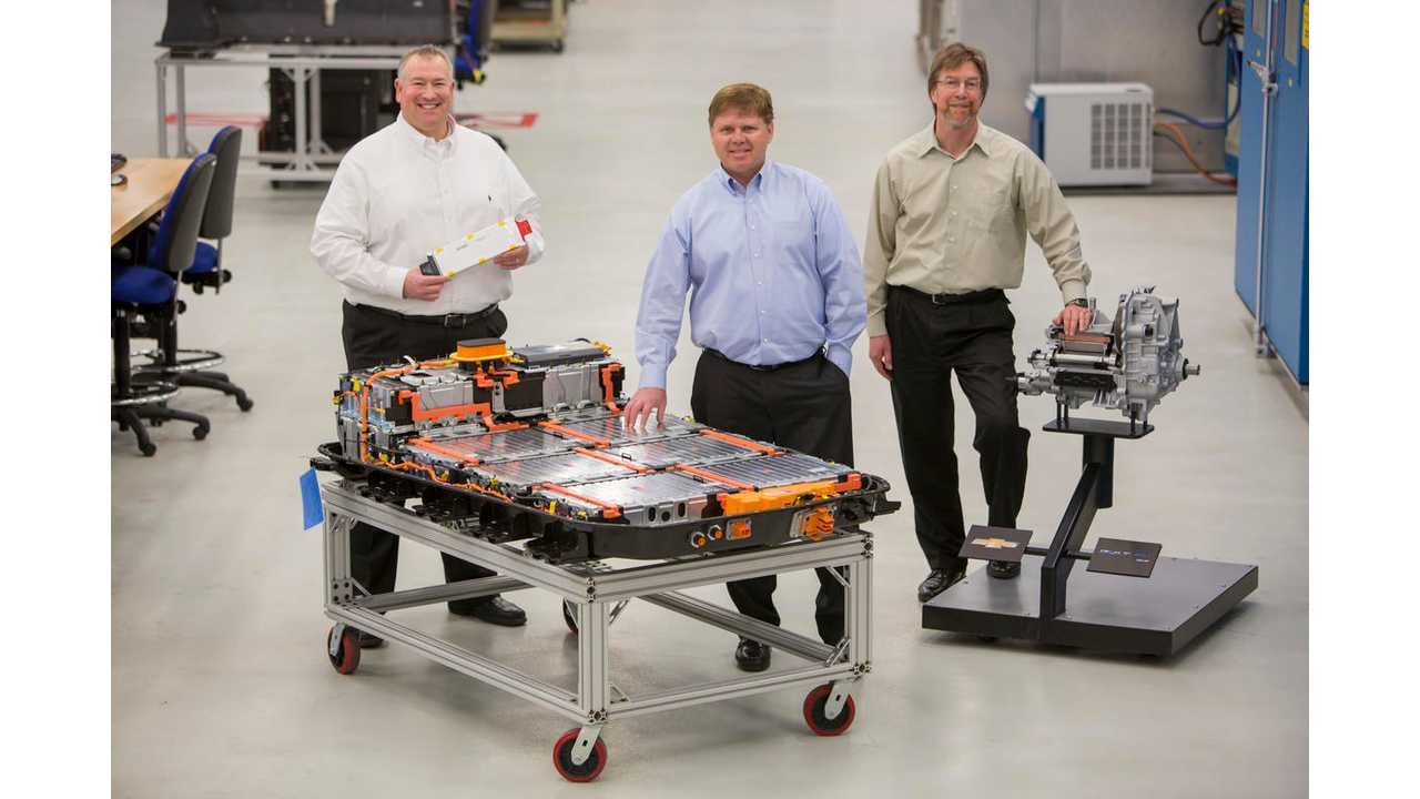 Greg Smith, Engineering Group Manager, Electrification, left, Tim Grewe, General Director, Electrification, center, and Stephen Poulos, Global Chief Engineer, Electrification, right, pose with a Chevrolet Bolt EV battery pack and drive unit in General Motors Global Battery Systems Laboratory at the GM Technical Center in Warren, Michigan, Tuesday, April 5, 2016. (Photo by Jeffrey Sauger for General Motors)