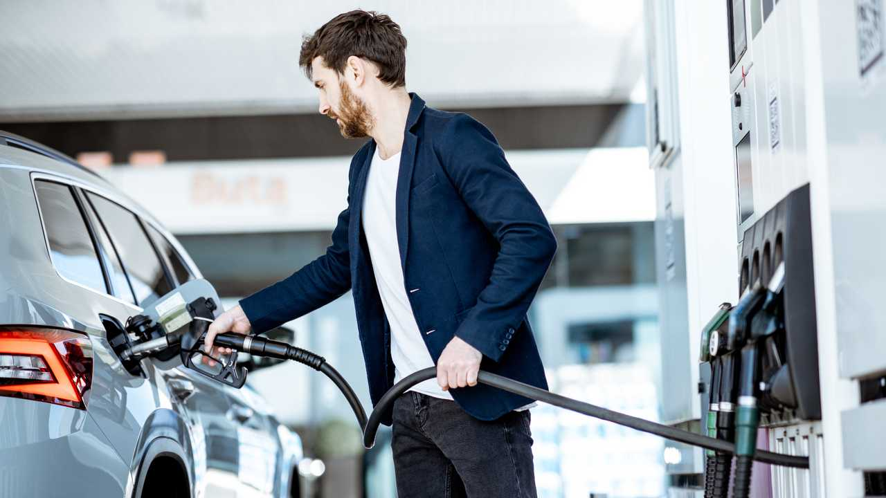 Man refuelling car at petrol station