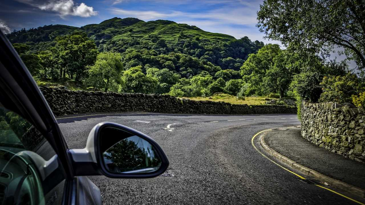 Driving a country road in the lake district in England