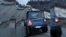 Jeep on busted road