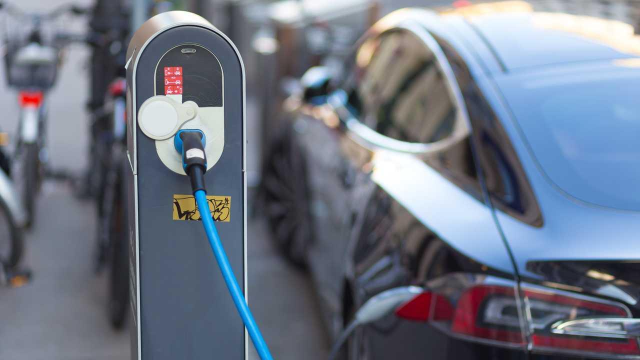 Tesla Model S charging at power supply station