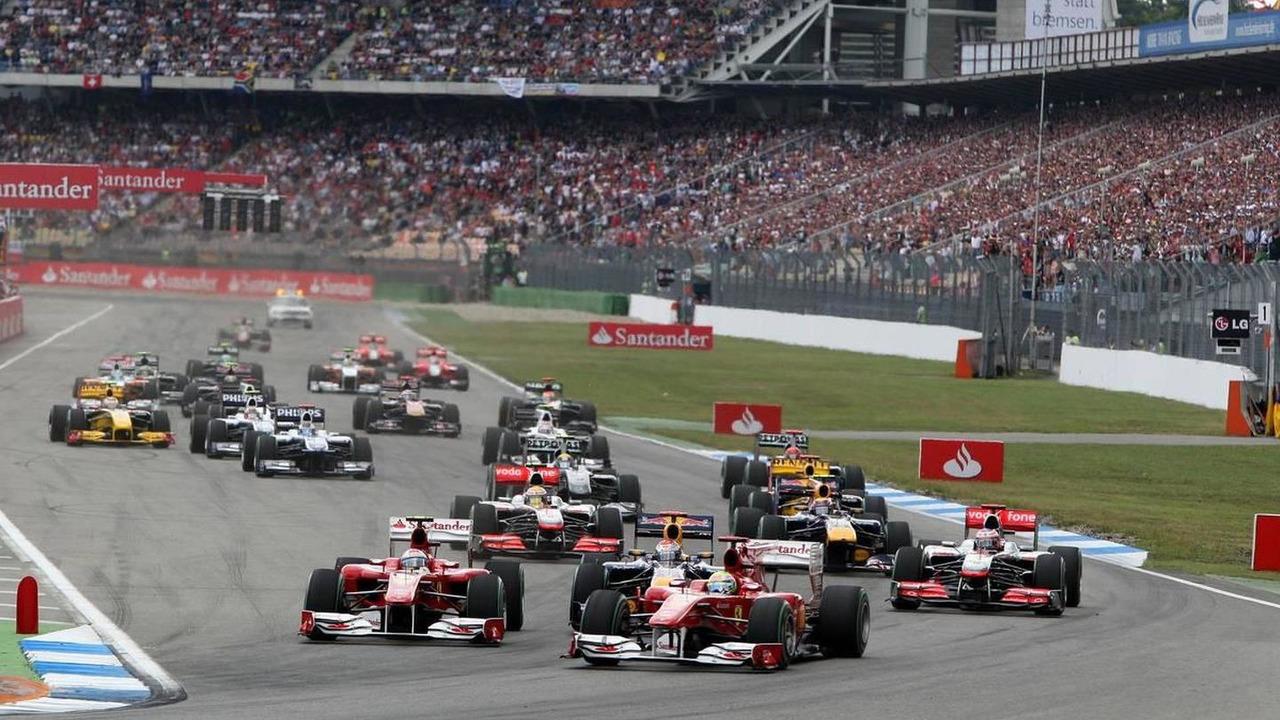 Felipe Massa (BRA), Scuderia Ferrari leads Fernando Alonso (ESP), Scuderia Ferrari and Sebastian Vettel (GER), Red Bull Racing at the start, German Grand Prix, 25.07.2010 Hockenheim, Germany
