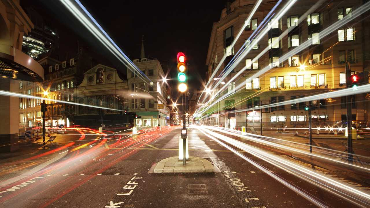 Traffic lights in the centre of London at night