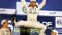 2015 champion Mark Webber celebrates on the podium