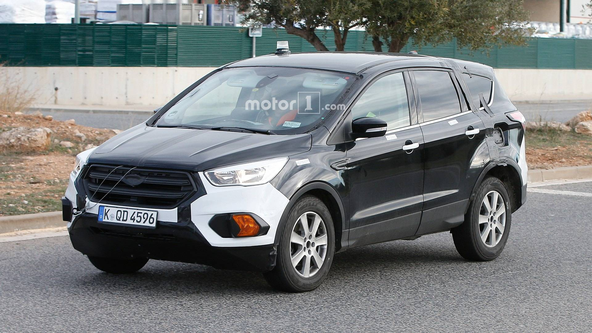 2020 ford kuga escape spied hiding underneath enlarged test mule