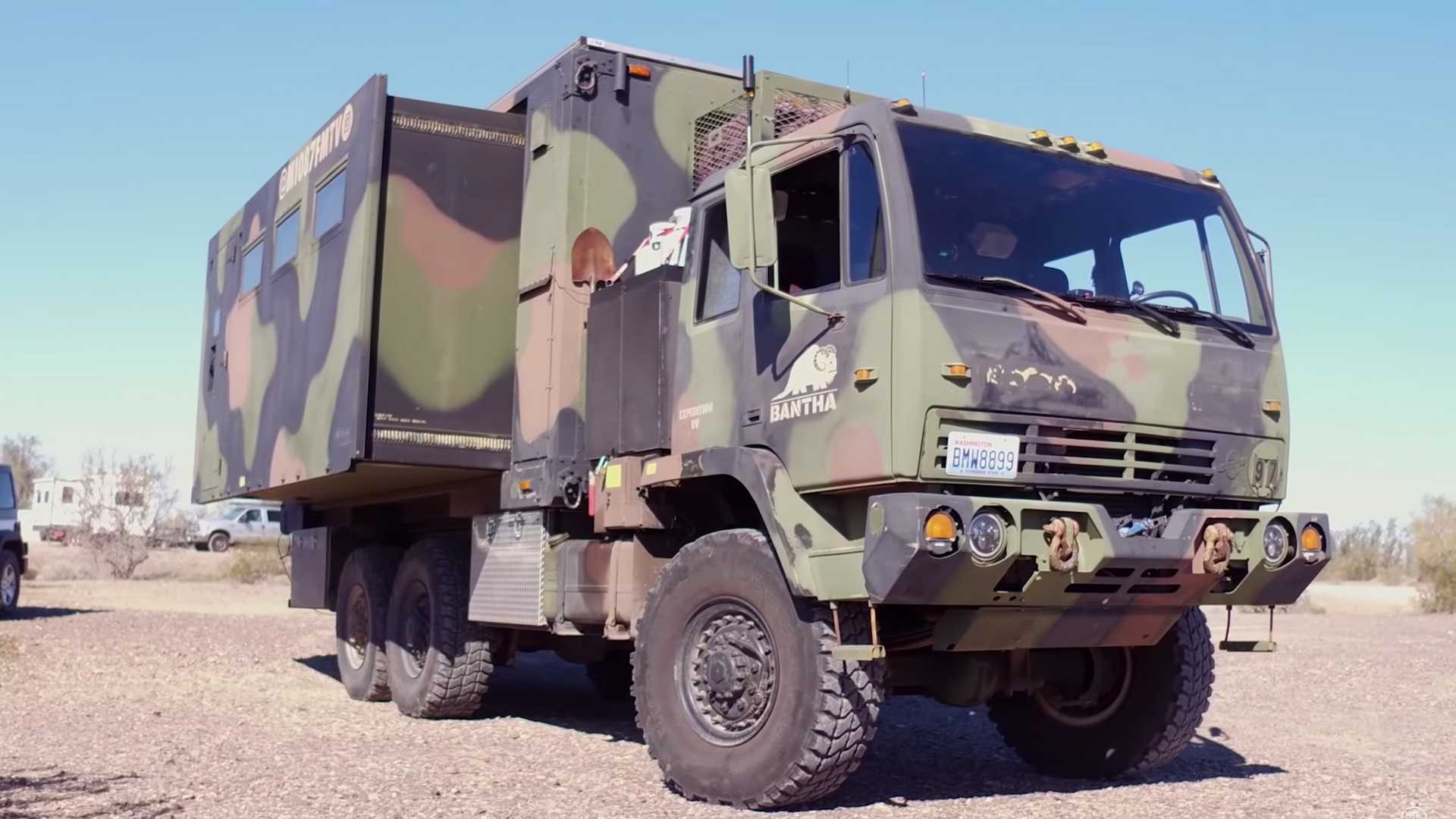 Military Truck With Extending Sides Becomes Camper With Solar Roof