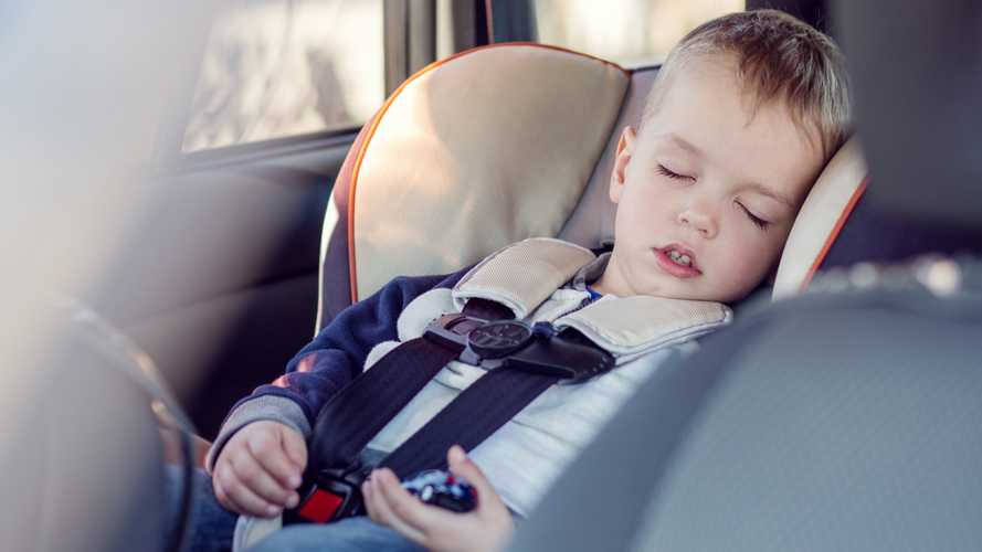 Boy sleeping in car seat