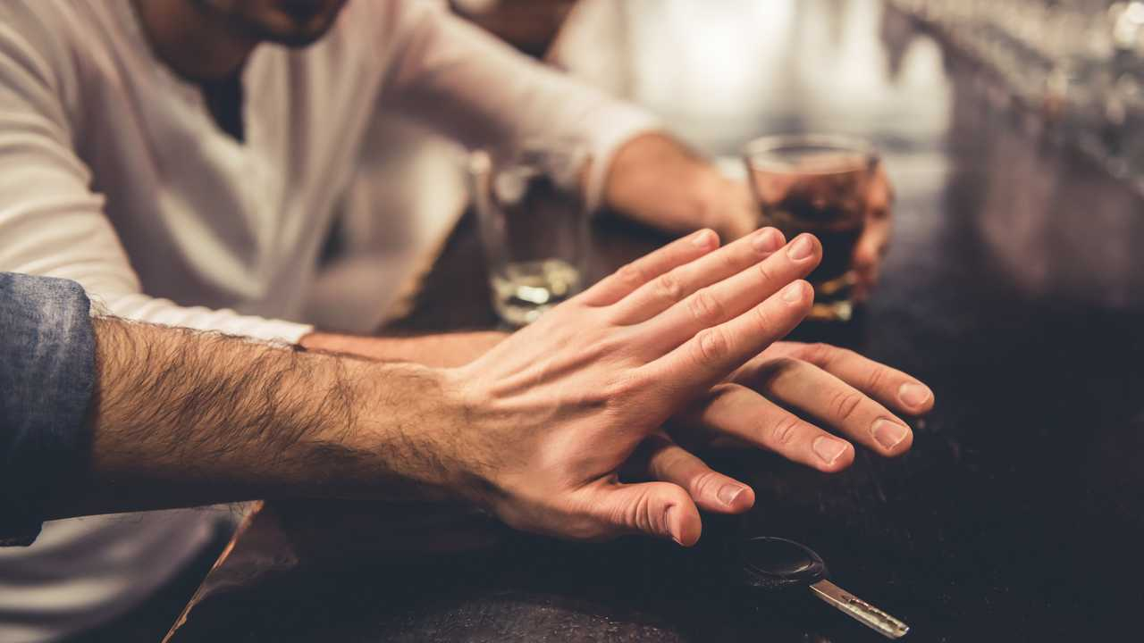 Drunk man at pub drinking alcohol stopped from talking car keys