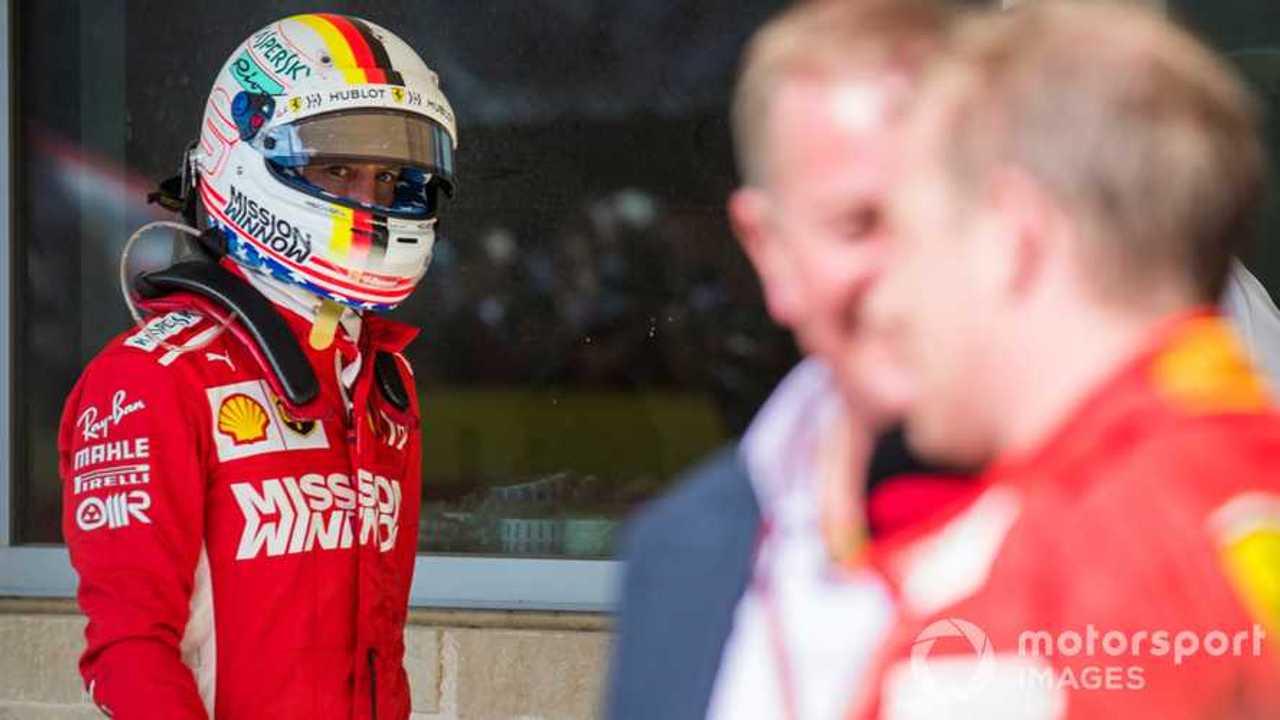 Sebastian Vettel looks over as race winner Kimi Raikkonen is interviewed US GP 2018