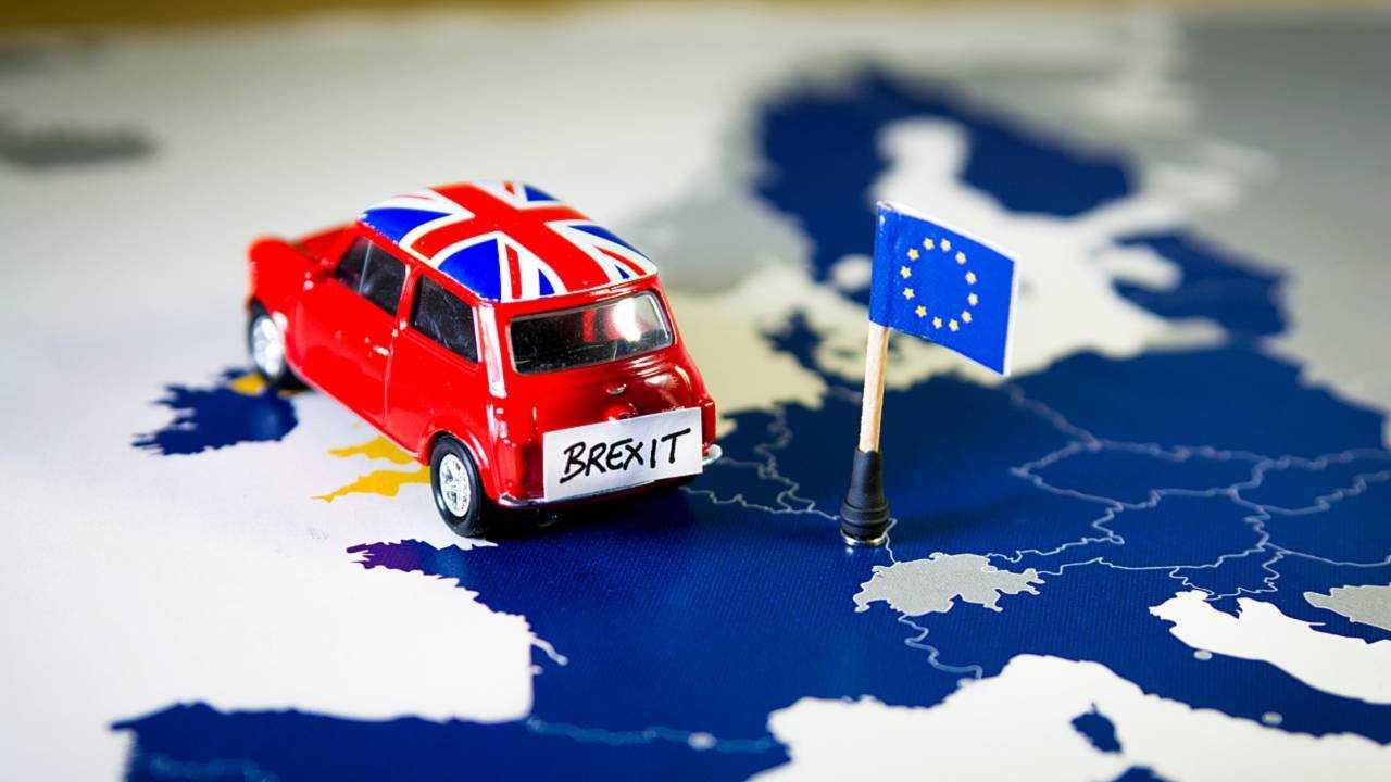 Mini Cooper over EU map symbolizing Brexit concept