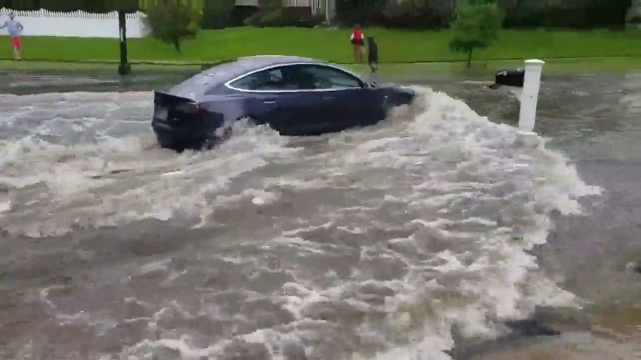 Watch This Tesla Model 3 Fly Down A Flooded Road Video