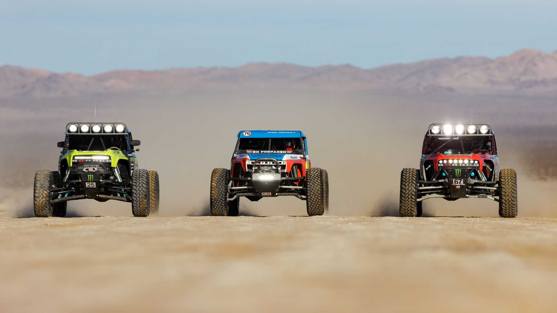https://cdn.motor1.com/images/mgl/LQO7j/s6/ford-bronco-ultra4-4400-unlimited-class-race-truck-together.jpg