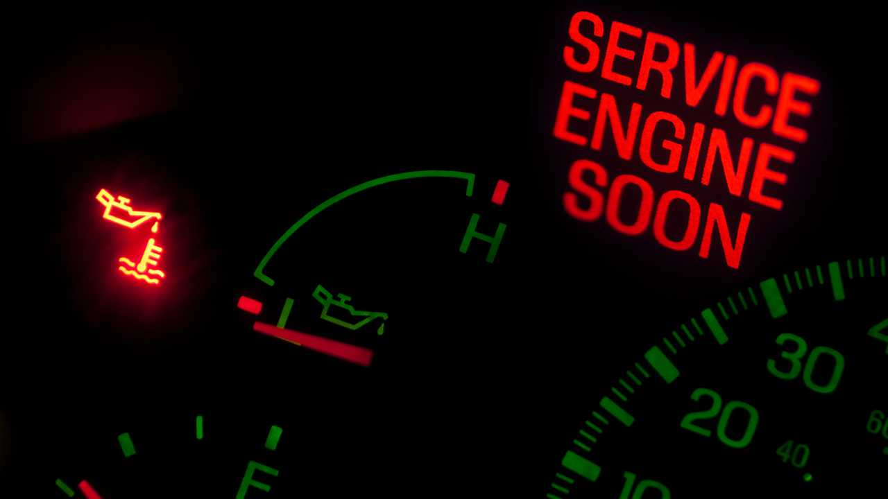 A check engine light illuminated on the instrument cluster of a vehicle.