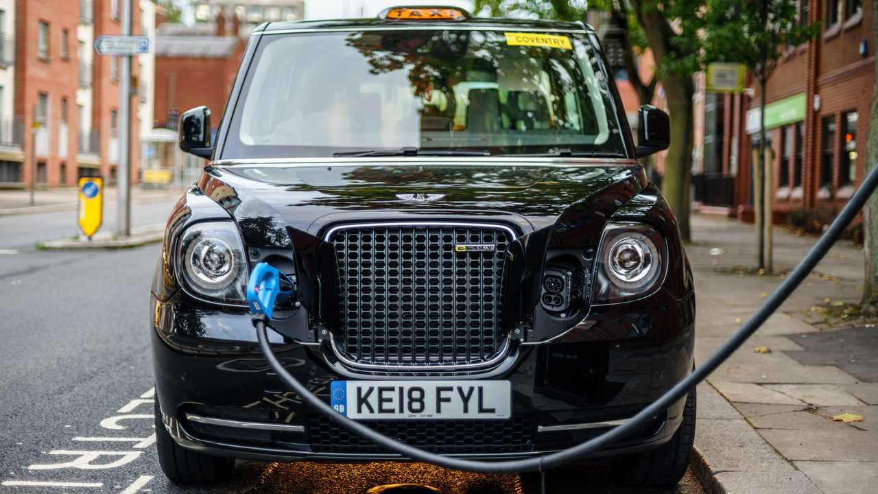 Electric London Taxi charging on street in Coventry