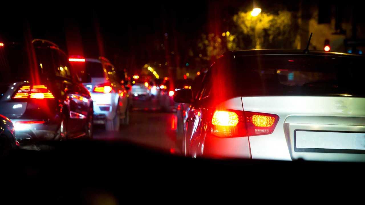 Car brake lights shining in night-time traffic jam