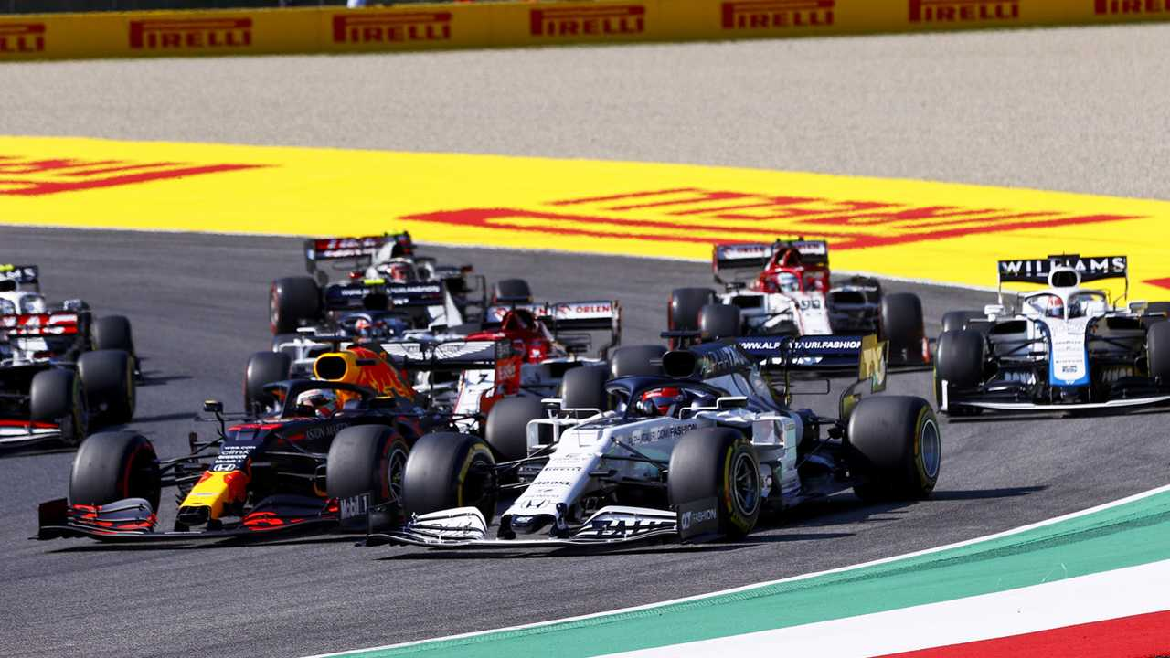 Daniil Kvyat, AlphaTauri AT01, battles with Max Verstappen, Red Bull Racing RB16, ahead of Kimi Raikkonen, Alfa Romeo Racing C39, George Russell, Williams FW43, and the remainder of the field at the start
