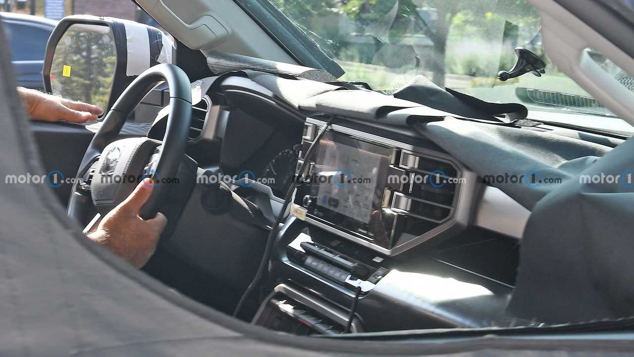 A spy photo particially reveals the interior of the new 2022 Toyota Tundra pickup truck.