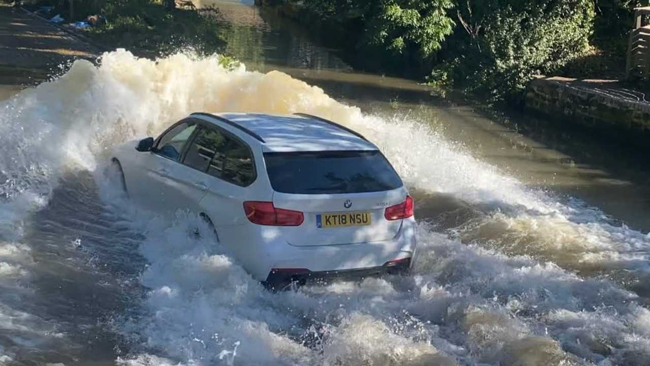 BMW 3 Series going through deep water
