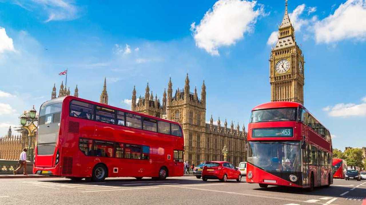 Big Ben, Westminster Bridge and red double decker bus in London