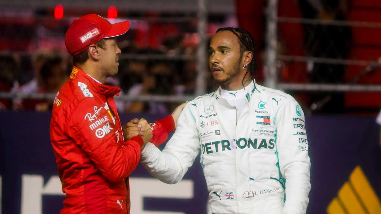 Sebastian Vettel, Ferrari and Lewis Hamilton, Mercedes AMG F1 celebrate in Parc Ferme