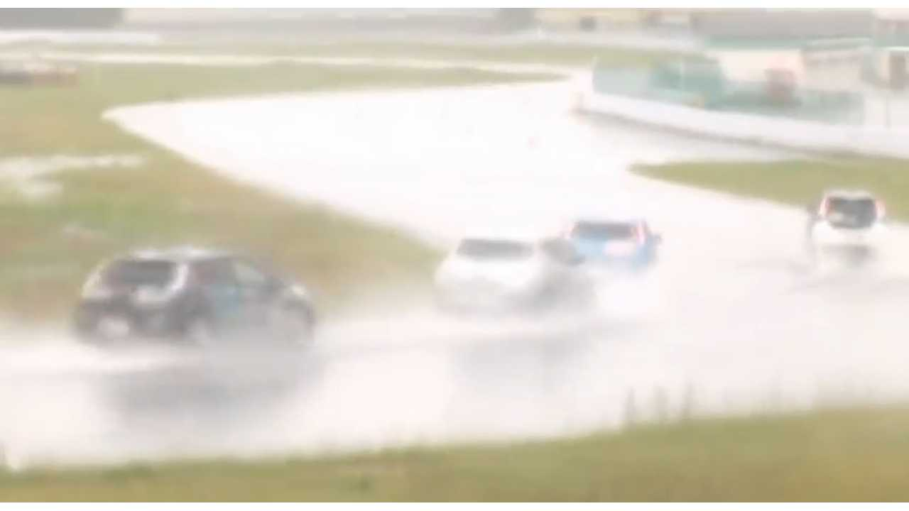 Nissan LEAFs and Mitsubishi i-MiEVs Racing In The Rain In Japan - Video