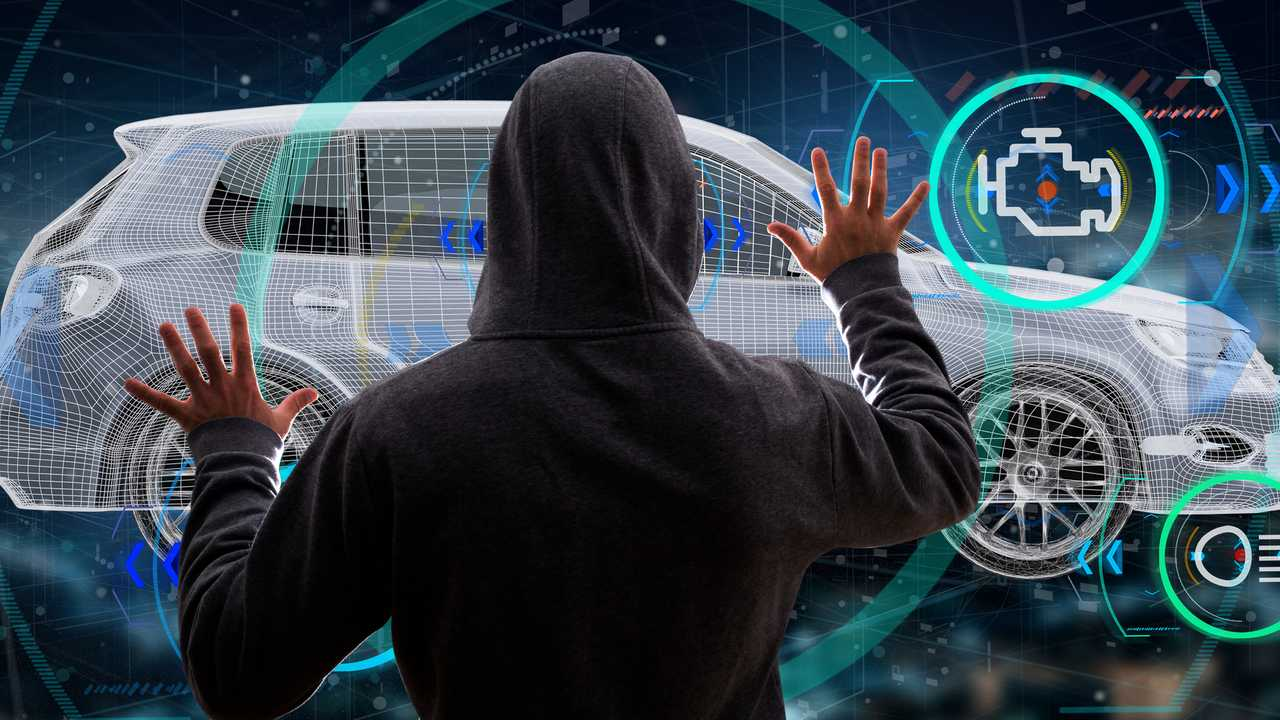 View of a hacker holding 3D rendering car concept