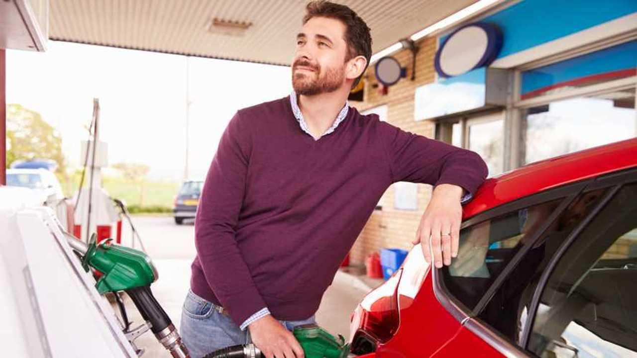 Man refuelling car at petrol station
