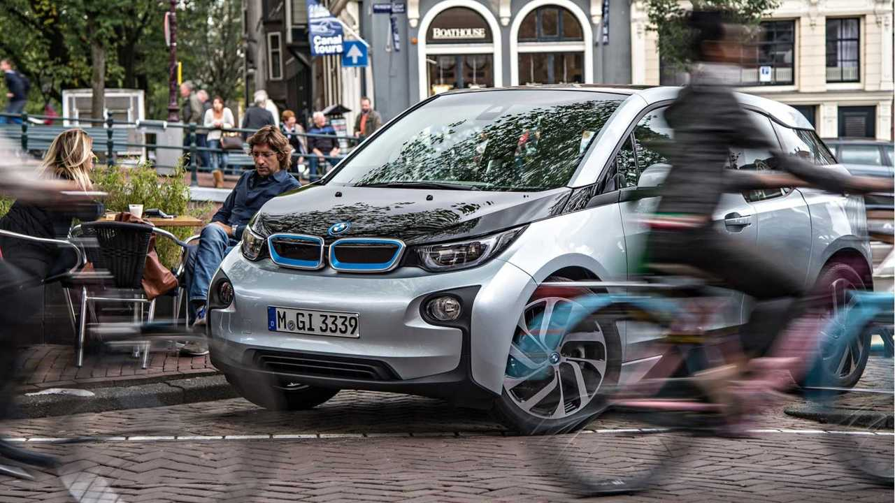 BMW i3 on street amongst pedestrians