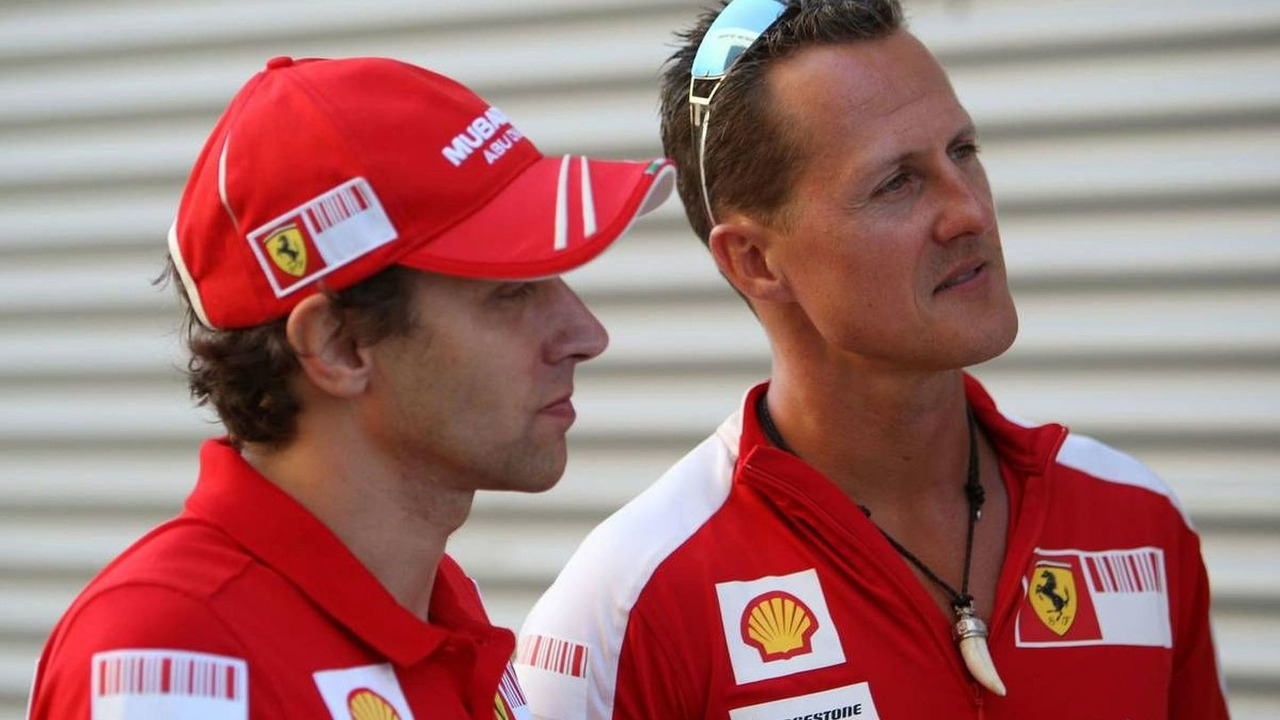Luca Badoer with Michael Schumacher at the 2009 European Grand Prix in Valencia on 22nd August